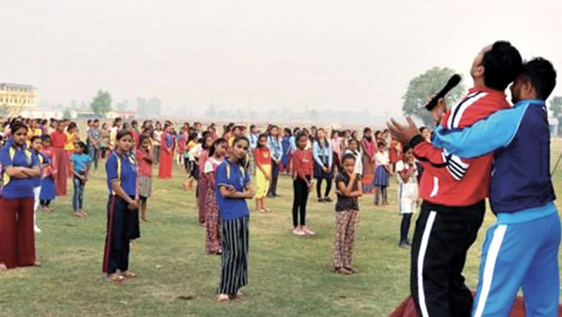 Photo of rows of women and girls observing self-defence moves at a course in Nepal on 29 April.