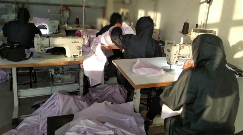 Covid_fundraising_Workers at KAVACH who usually produce motorcycle clothing prepare PPEs ©KAVACH